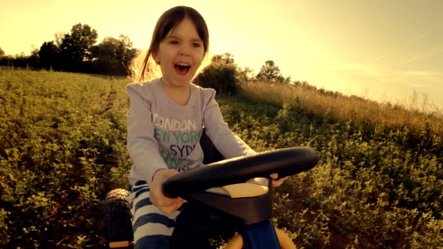 happy memories of her young days- a child of tree drive go-chart, off-road - learning to drive stock videos & royalty-free footage