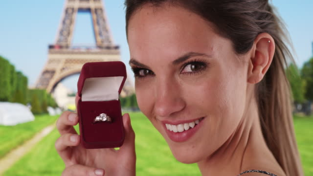 happy millennial girl showing off engagement ring by eiffel tower in paris - jewelry box stock videos and b-roll footage