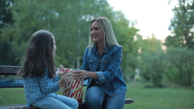 happy mommy and daughter - popcorn stock videos & royalty-free footage