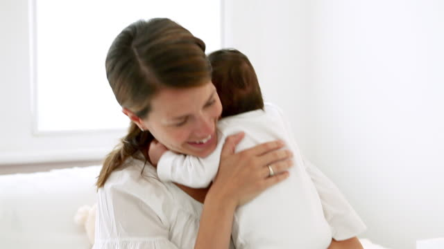 happy mother and baby - burping stock videos & royalty-free footage
