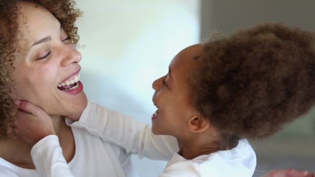 CU Happy Mother and Daughter Kissing and Laughing Together / Richmond, Virginia, United States