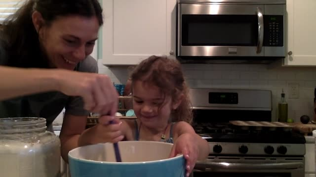 happy mother and daughter make a mess mixing ingredients in bowl together (audio) - audio available stock videos & royalty-free footage