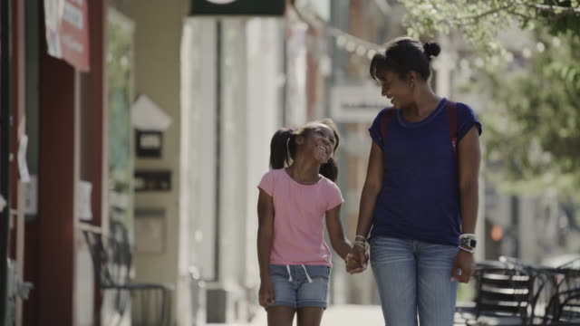 happy mother and daughter walking and talking on city sidewalk / provo, utah, united states - provo stock videos & royalty-free footage