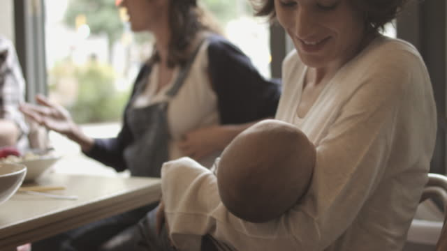 happy mother playing with baby boy in restaurant - family with two children stock videos & royalty-free footage