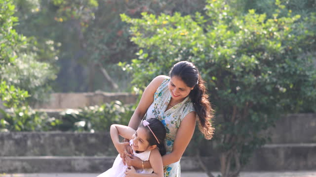 happy mother playing with his daughter at park - childhood stock videos & royalty-free footage