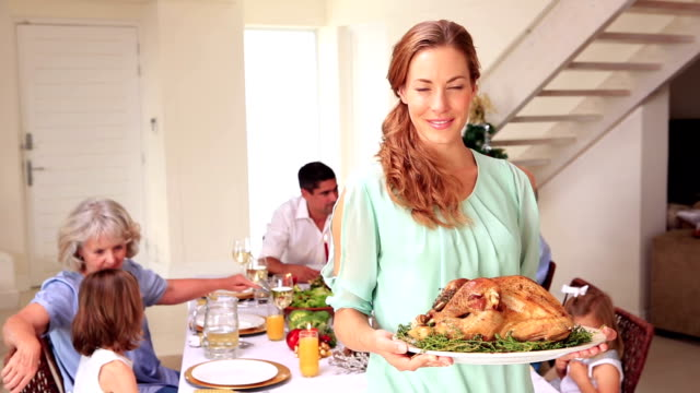 happy mother showing roast turkey to camera - roast turkey stock videos & royalty-free footage