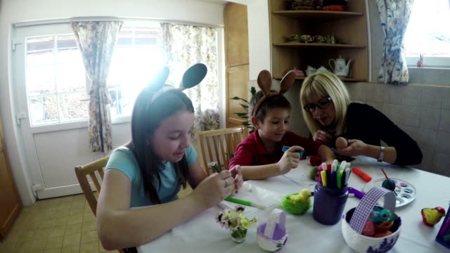 happy mother with children painting easter eggs at home - gouache stock videos & royalty-free footage