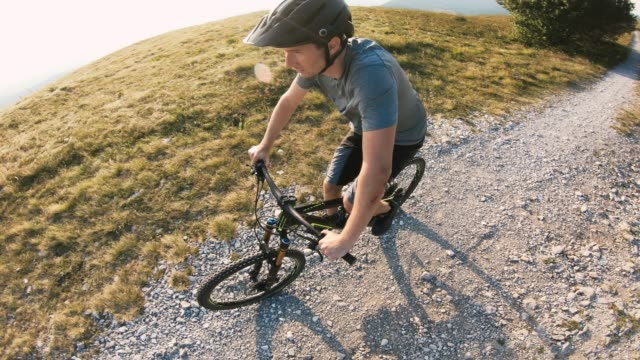 happy mountain biker cycling off road - sports helmet stock videos and b-roll footage