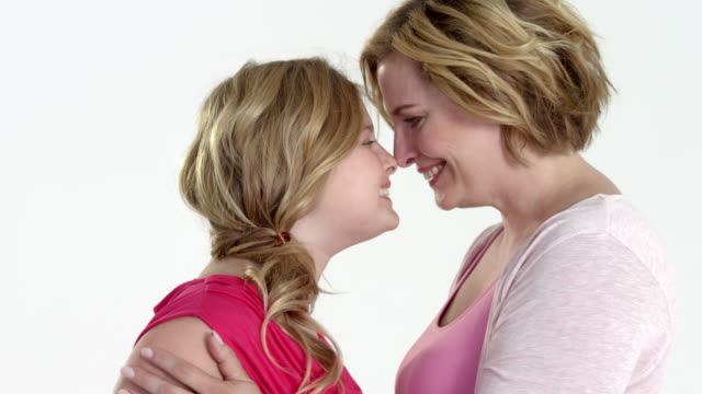 happy mum and daughter - on rotating turntable - angesicht zu angesicht stock-videos und b-roll-filmmaterial