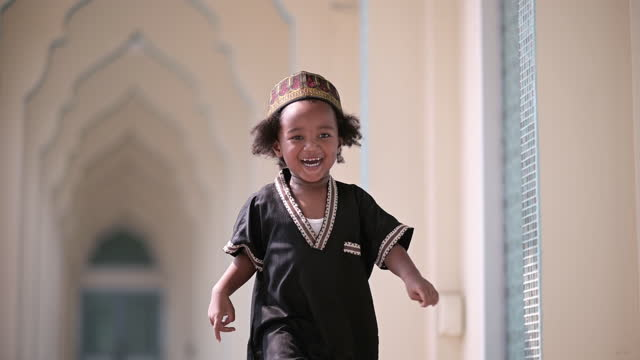 happy muslim boy at mosque - middle east stock videos & royalty-free footage