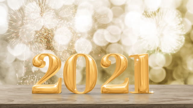 happy new year 2021 gold glossy with fireworks on modern wood table and leg with sparkling gold bokeh wall,holiday celebration concept - new year's eve stock videos & royalty-free footage