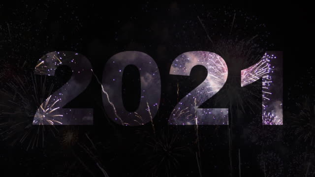 happy new year 2021 text appearing in the front of wonderful fireworks,fireworks display 2021 - new year's eve stock videos & royalty-free footage