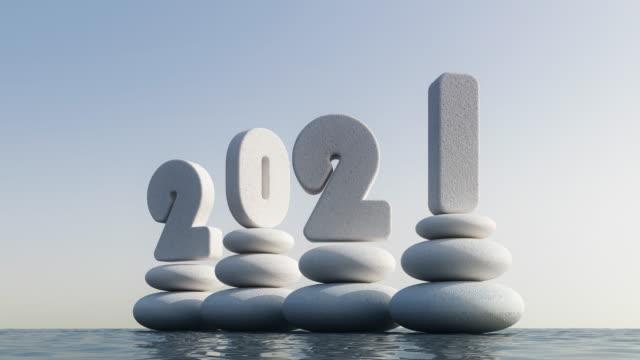 vídeos de stock, filmes e b-roll de feliz ano novo 2021 - pedra solta
