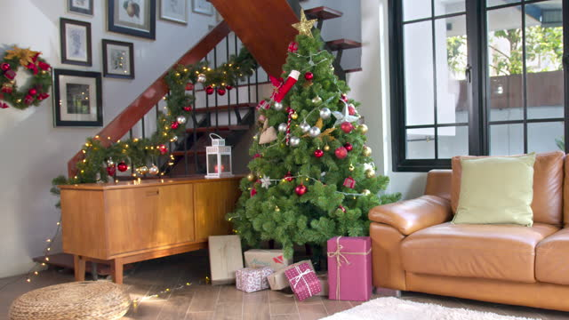 happy new year and merry christmas, decorated christmas tree in living room, new year concept and christmas background concept - ornate stock videos & royalty-free footage