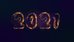 2021 happy new year. Figures from gold coins. Sparkling particles form the symbols of Christmas.
