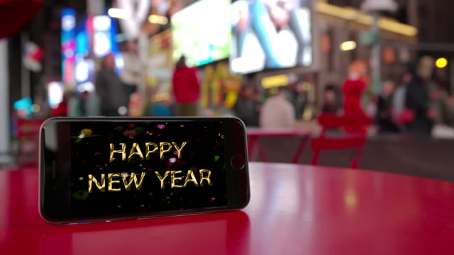 Happy new year Times Square New York smartphone celebration crowd