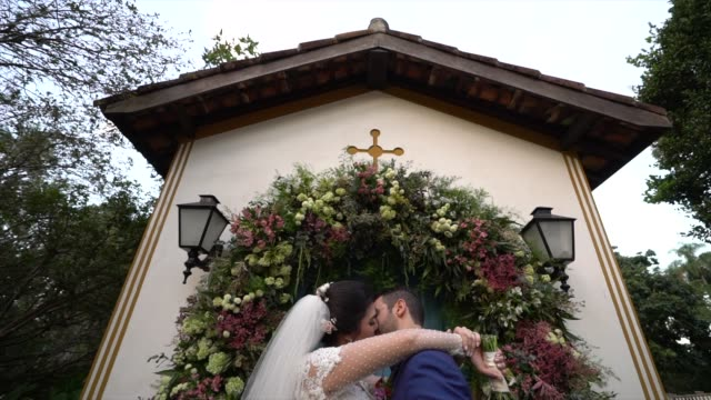 happy newlywed couple kissing at the chapel - chapel stock videos & royalty-free footage