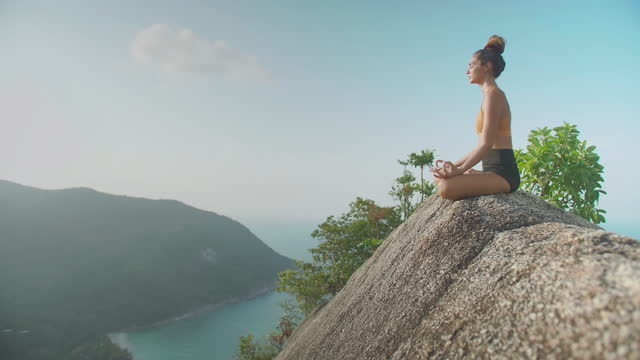 happy of young women age 29 yearold of latin american and hispanic ethnicity doing practice yoga on the top of mountain ocean summit.happiness in nature concept. - wonderlust stock videos & royalty-free footage