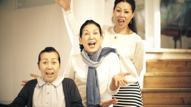 happy older ladies posing - アクティブシニア点の映像素材/bロール
