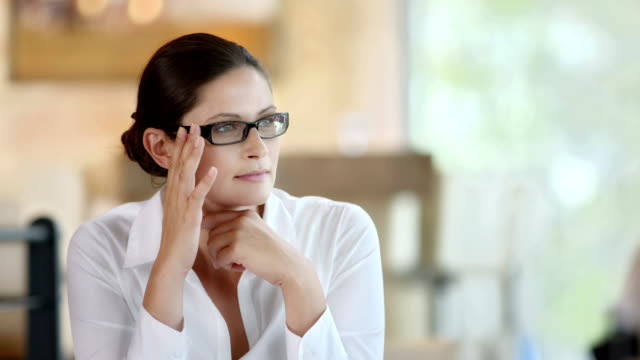 HD DOLLY: Happy Pensive Woman At The Café