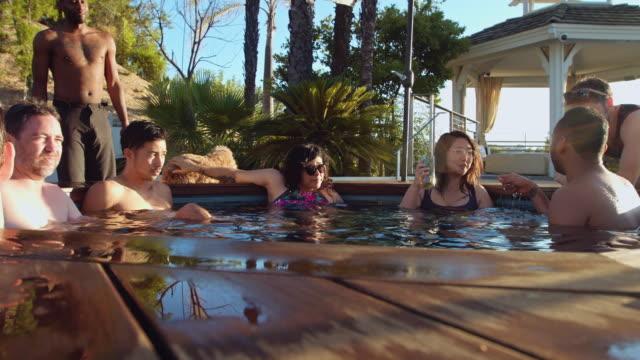 Happy People Enjoying Hot Tub at Pool Party