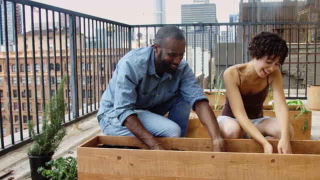 Happy People in Rooftop Vegetable Garden