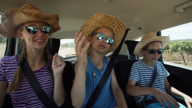 happy playful kids travelling by car - cowboy hat stock videos & royalty-free footage