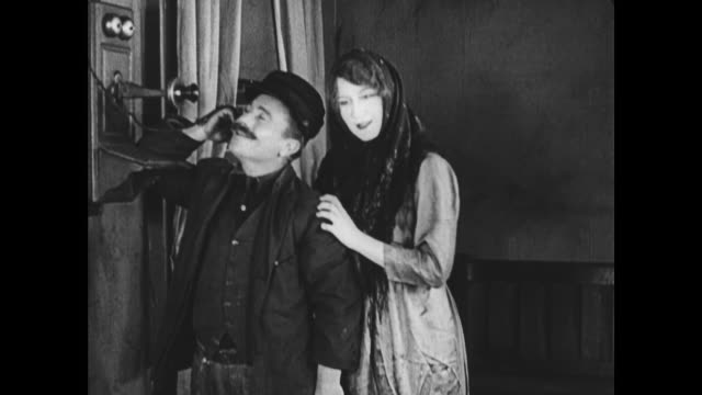 vídeos y material grabado en eventos de stock de 1922 happy polish couple telephone priest requesting marriage ceremony in native language - poland