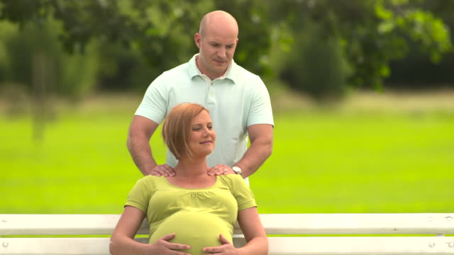 HD: Happy Pregnant Couple In The Park
