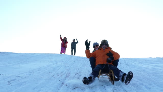 happy retirees enjoying tobogganing - winter sport stock videos & royalty-free footage
