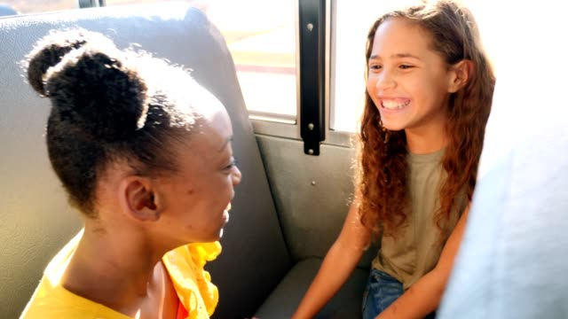 happy schoolgirls enjoy playing clapping game while on school bus - schoolgirl stock videos & royalty-free footage