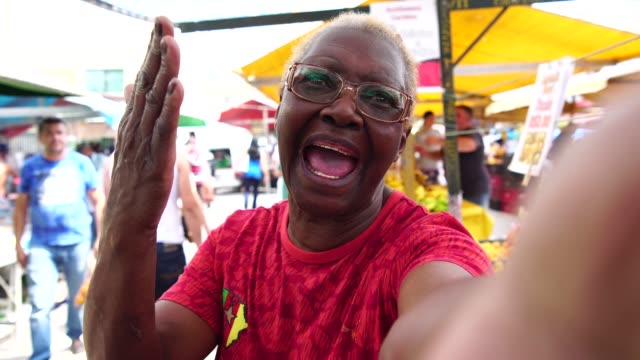 happy senior african woman taking a selfie - africa stock videos & royalty-free footage