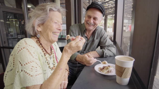 happy senior couple enjoy coffee and cake - 70 79 years stock videos & royalty-free footage