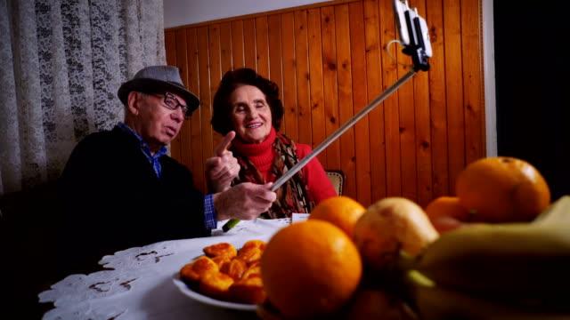 Happy senior couple taking selfie