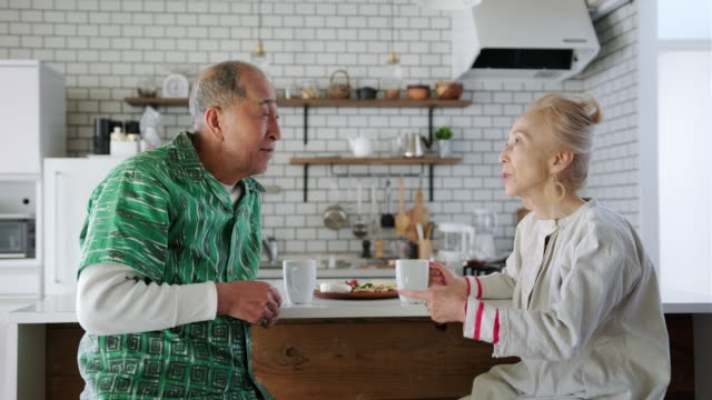 happy senior japanese couple enjoying in the kitchen - comfortable stock videos & royalty-free footage