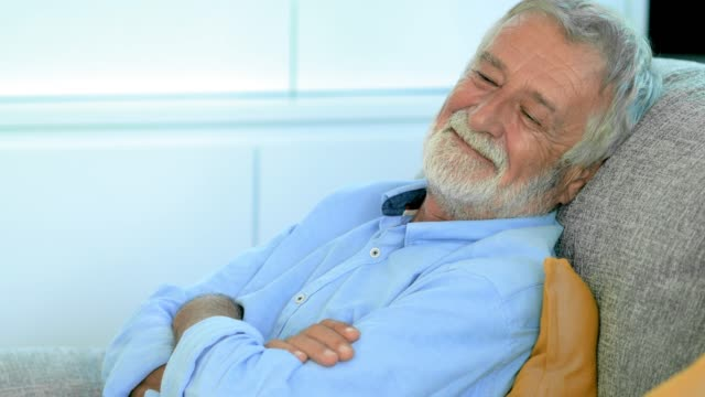 happy senior napping - napping stock-videos und b-roll-filmmaterial