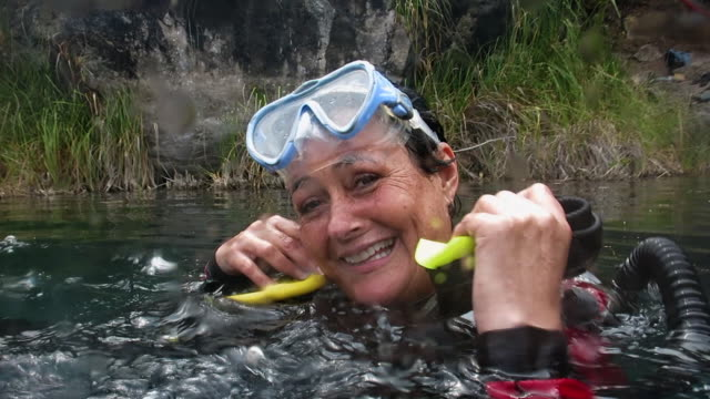 happy senior woman after her dive. - older woman fun stock-videos und b-roll-filmmaterial