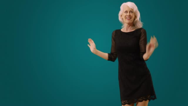 happy senior woman dancing in a black dress - only senior women stock videos & royalty-free footage