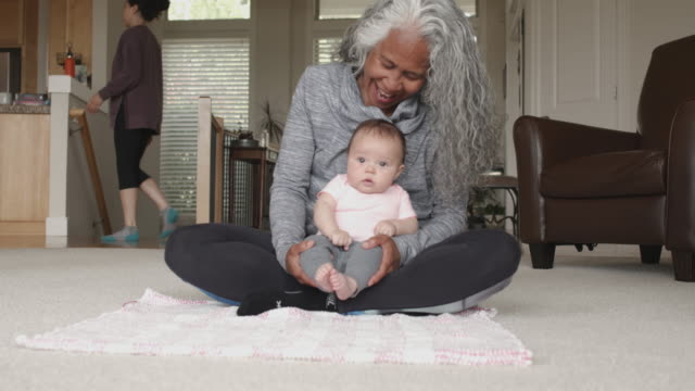 happy senior woman playing with her adorable baby grandchild - asian and pacific islander stock videos & royalty-free footage
