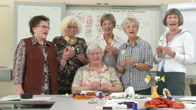 hd dolly: happy senior women posing during craft class - choir stock videos and b-roll footage