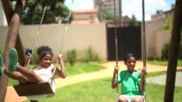 Happy sibling swinging
