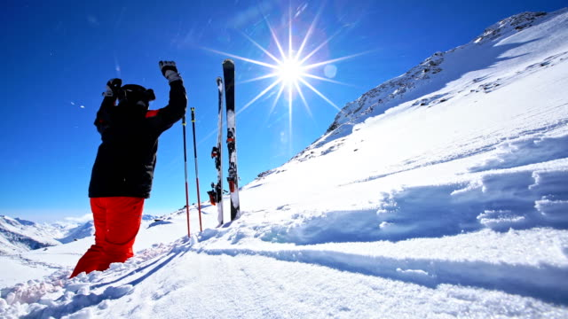 happy skier on top of ski resort - goggles sportswear stock videos and b-roll footage
