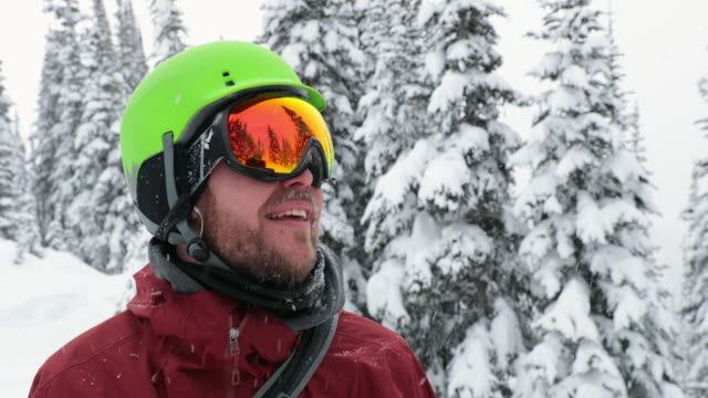 Happy Skier Snowboarder Outdoor During Snowstorm