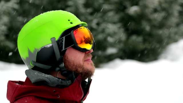 happy skier snowboarder outdoor during snowstorm - snowboard video stock e b–roll