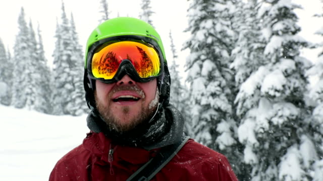 happy skier snowboarder outdoor during snowstorm - ski goggles stock videos & royalty-free footage