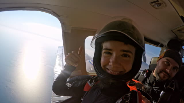happy skydivers on the plane - helmet stock videos & royalty-free footage