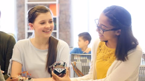 happy stem high school students make robotic vechicle - teenagers only stock videos & royalty-free footage