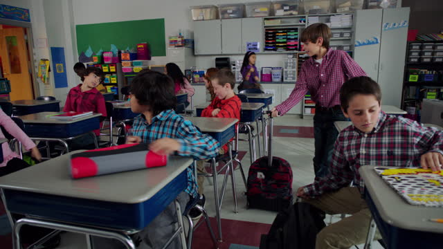 happy students file into class and interact as they prepare for class. - backpack stock videos & royalty-free footage