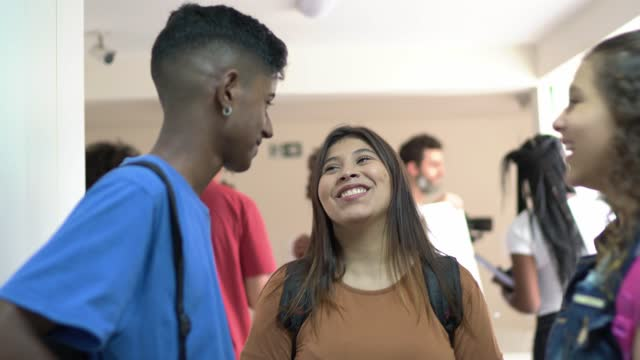 happy students talking in the school's corridor - community college stock videos & royalty-free footage