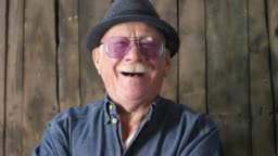 Happy Stylish Elderly Man Laughing